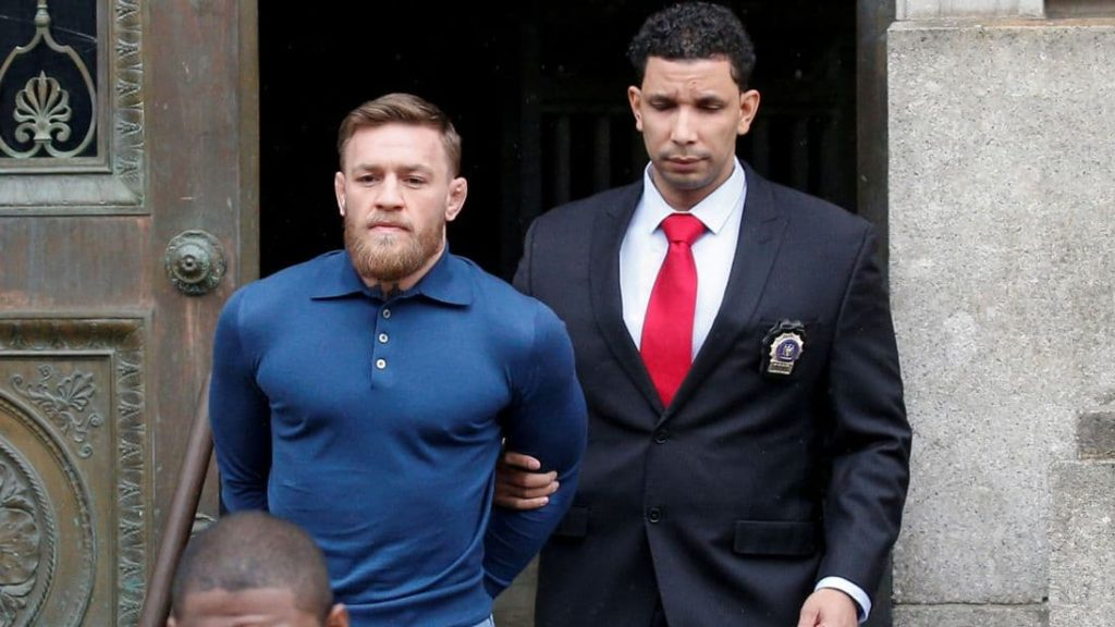 UFC star Conor McGregor is lead away in handcuffs
