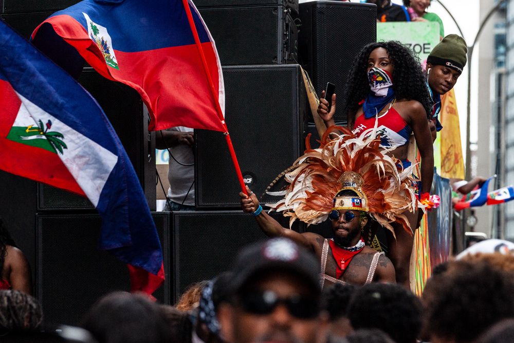 Haitian flags are proudly flown at Carifesta 2019 // Photo : Kieron Yates